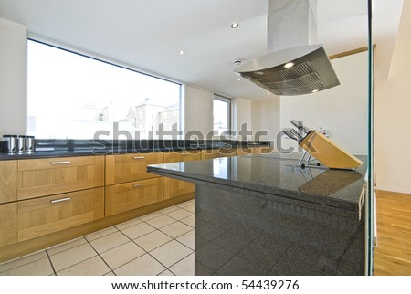 Brand new contemporary open plan kitchen with modern appliances and cons