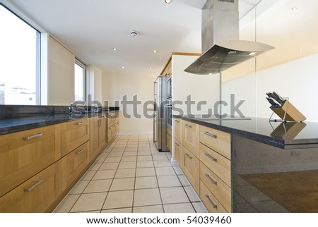 Brand new contemporary open plan kitchen with modern appliances and double amirican style fridge