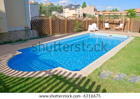 Brand new garden swimming pool with sparkling fresh water. Relaxing pergola with wooden garden furniture.