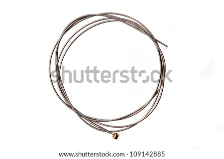 Brand new guitar string, isolated on white.