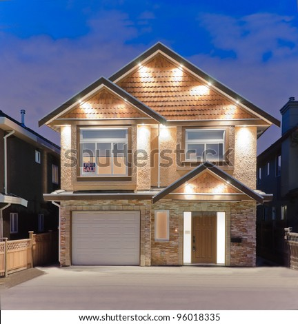 Brand new house for sale   in suburbs at dusk in Vancouver, Canada