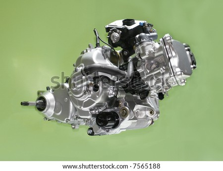 Brand new motorcycle engine isolated over green