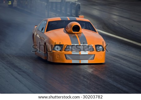 stock-photo-brand-new-orange-dragster-in-fast-motion-down-the-strip-30203782.jpg