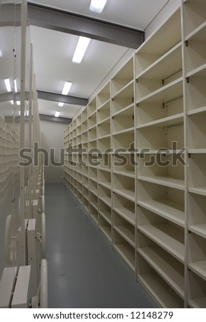Brand new records storage room, beige metal shelves with lots of space.