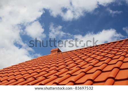 Brand new red rooftop against blue sky
