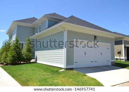 Brand New Suburban American House with Attached Two-Car Garage
