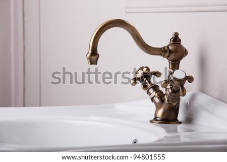 Brand new water tap on bright background