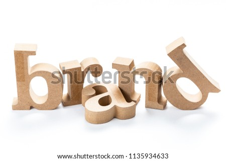 BRAND wood word isolated on white background, brand building, brand topic concept