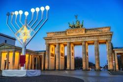 Brandenburg gate and and hanukkah menorah in Berlin, Germany