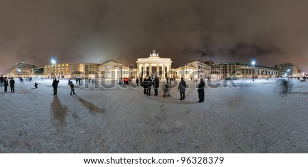 Brandenburg Gate and Pariser Platz in Berlin, Germany. Panorama is made late cloudy January evening. 360 degree panoramic composition.
