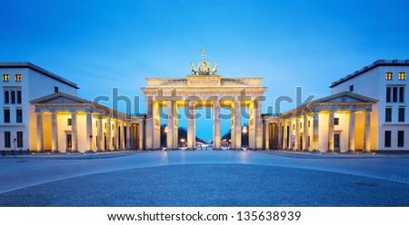 Brandenburger Tor (Brandenburg Gate) panorama, famous landmark in Berlin Germany at night - stock photo