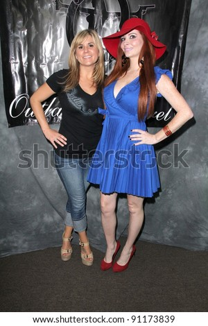 "Passante, Phoebe Price at the Grand Opening of ""Storage Wars"" Jarrod"