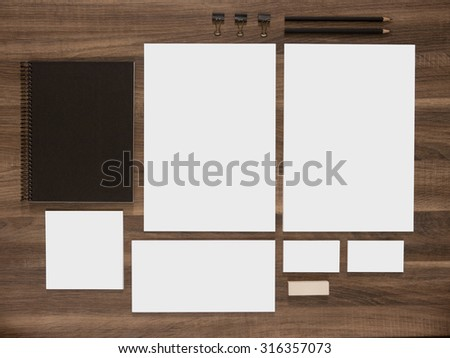 Branding mockup collection for corporate identity presentation. Blank business cards with documents, envelopes and black notepads on wood desk.