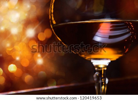 brandy for the maestro, snifter with brandy on a piano.