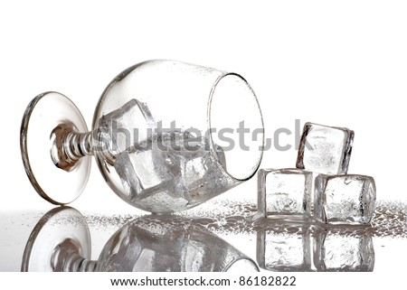 brandy glass with ice cubes