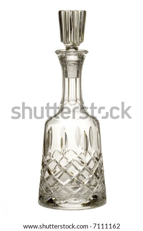 Brandy, whiskey or wine cut crystal decanter isolated on white