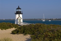 Brant Point Lighthouse guides boaters into the harbor on Nantucket Island on a late afternoon summer day.