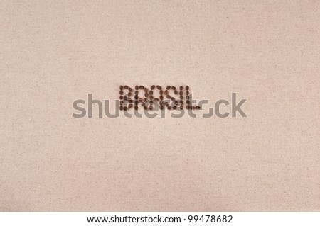 Brasil written with coffee beans in the center of a burlap background