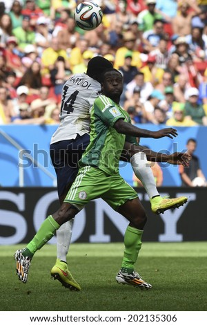 BRASILIA, BRAZIL - June 30, 2014: A team member from  France and a team member from Nigeria compete for the ball during the World Cup Round of 16 game between France and Nigeria at Mane Garrincha Stadium