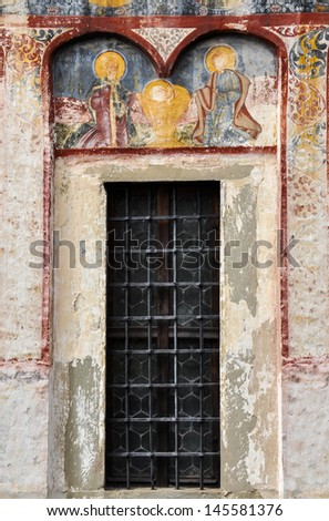 BRASOV - JUNE 6: Painted murals and fresco on the wall of the Saint Nicholas Church, a Romanian Orthodox church in Brasov, dominating the historic district of Schei. On June 6 in Brasov, Romania
