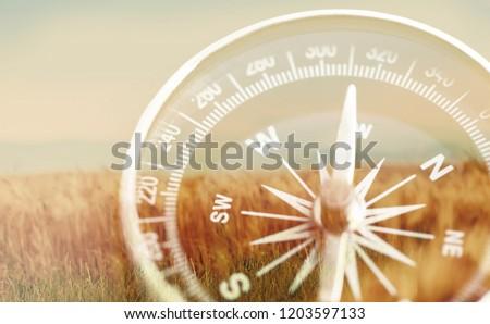 Brass antique compass  on background #1203597133