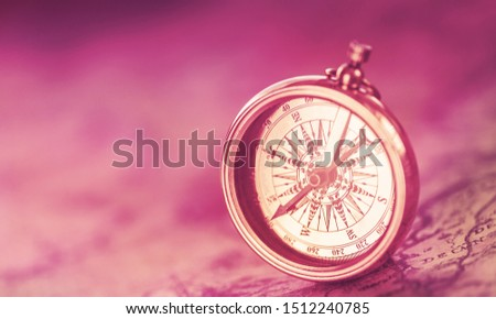 Brass antique compass  on background