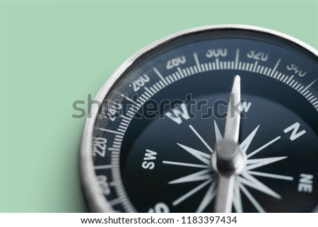 Brass antique compass on grey background #1183397434