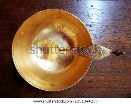 Brass Bowl on wooden table