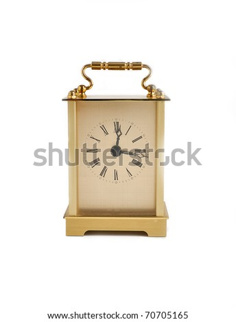 Brass carriage clock isolated on white background