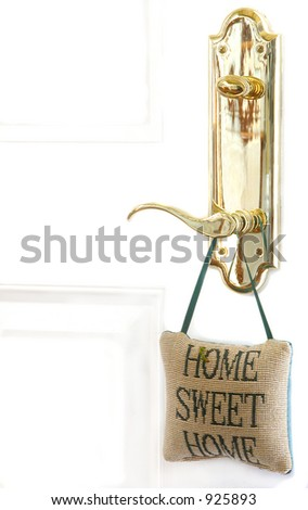 Brass door handle with cross stitched pillow