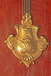 Brass engraved blazon ornament decoration over wood