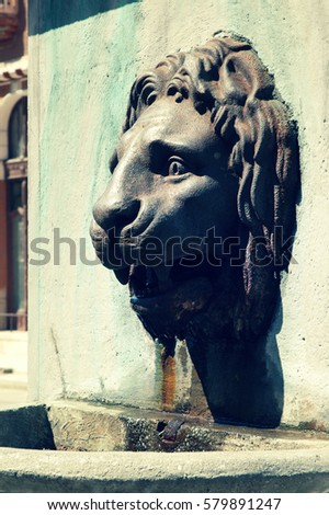 brass fountain statue of a lion ...