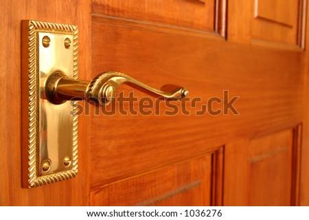 Brass handle on pine door