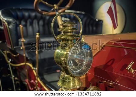 Brass headlight lamp retro vintage car, close up #1334711882