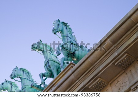 Brass horses over neoclassical ceiling