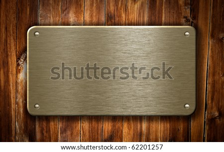 brass metal plate on wooden background