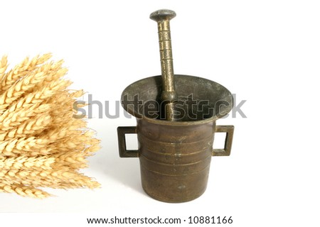 Brass mortar and pestle with wheat