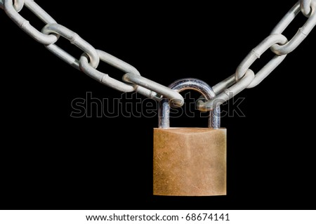 Brass padlock locked onto a heavy galvanized chain, isolated on a black background