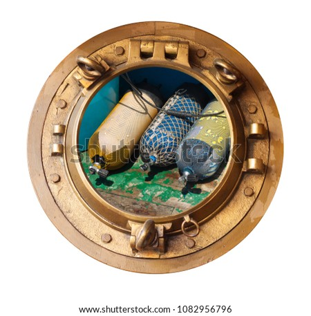 brass porthole and aqualungs on wooden deck #1082956796
