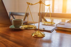 Brass scales are placed on the tables within the lawyer's office for use as decorations and as a symbol of justice in judicial proceedings. Brass scales are a symbol of justice in court hearings.