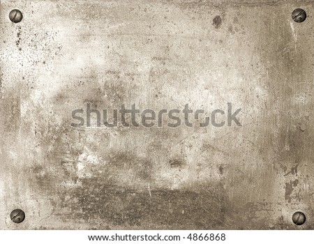 Brass shiny metal plate with screws background texture