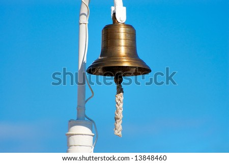 Brass ship's bell with thick rope hanging