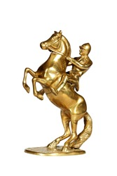Brass statue of the jockey on a horse isolated over white with clipping path.