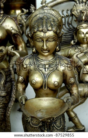 Brass statuette in a street shop, New Delhi, India