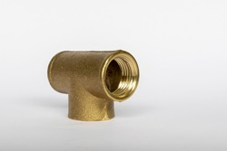 Brass T adapter for connecting tubes on white background and space for text