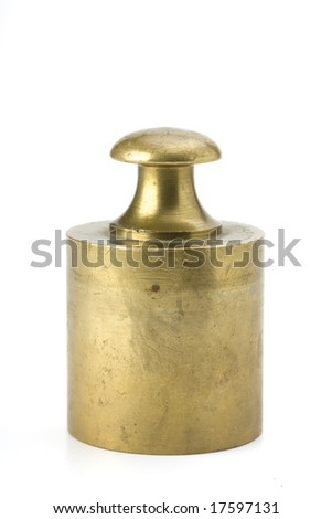 brass weight on white background