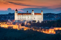 Bratislava castle over Danube river after sunset in the Bratislava old town, Slovakia