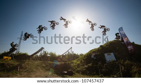 BRATISLAVA, SLOVAKIA - APRIL 28: jump sequence of Frantisek Maca (CZE) performing trick at FMX session on April 28, 2012 in Bratislava, Slovakia (Multiple Exposure)