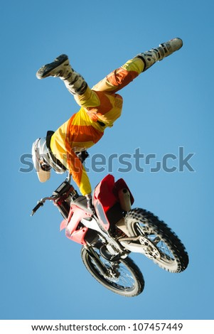 BRATISLAVA, SLOVAKIA - APRIL 28: Peter Hujber (HUN) performs trick in the air at FMX session on April 28, 2012 in Bratislava, Slovakia