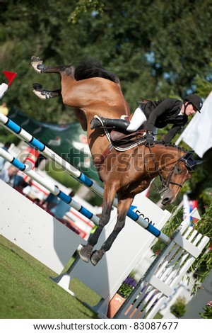 BRATISLAVA, SLOVAKIA - AUGUST 13: Aymeric Azzolino on horse Loping D'elle jumps over hurdle at Grand Prix Bratislava on August 13, 2011 in Bratislava, Slovakia